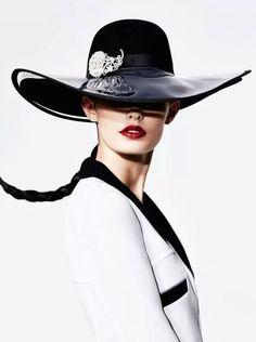 Black hat with floral embellishment