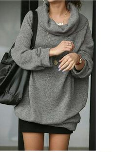 I'm not sure why I like this so much.. But pretty cool... baggy sweatshirt and mini skirt?!