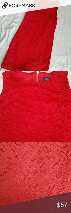 Vince Camuto coral sleeveless sheath dress size 4 Paisley lace covers this bold, contemporary sheath dress. Dress features a bateau neck,  thick sleeveless shoulders and exposed rear gold zipper. Color is a bright pink.  Shell is 50% cotton, 50% nylon. Lining is 100% polyester. Dress is fully lined. Worn once, brand new condition.  Measures 35.5 inches top to bottom, 16.5 inches armpit to armpit, 2.5 inches sleeve. Vince Camuto Dresses Wedding