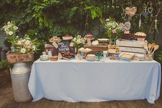 Wedding dessert table with rustic crates, vintage crockery and pretty flowers from And The Dish Ran Away With The Spoon   The Natural Wedding Company