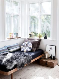 """The daybed, It's that piece of furniture that graced your childhood room (or was that just me?) that you resented because it didn't look like a """"real"""" bed, but now, as an adult, you realize is far more chic and useful and full of potential than you ever gave it credit for. The daybed is a really smart solution to tiny space living. Now, the daybed comes in many varieties. Check out these 15 gorgeous rooms where the daybed is the star."""