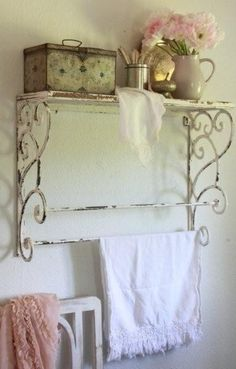 A shelf like this hung above the toilet could be a beautiful place to display vintage lace linen hand/tea towels  #Shabby