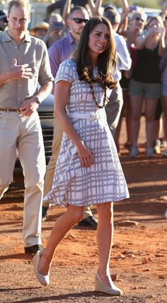 Catherine, Duchess of Cambridge and Prince William, Duke of Cambridge walk around the base of Uluru