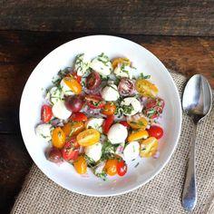 Cherry tomatoes and small mozzarella balls makes this a fun and versatile caprese salad // Endurance Zone