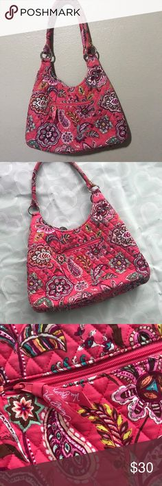 Large Vera Bradley purse Brand- Vera Bradley   ***EUC pink paisley print LARGE purse. Clean on inside and outside- hidden magnetic closure- hot pink paisley print on outside and a cute diamond print on the inside. This is more like a real purse instead of the standard cloth bags- hard bottom shell- thick straps. 16 inches wide/14 inches long. One outside zipper pocket, three pockets inside with another inside zipper pocket Vera Bradley Bags Shoulder Bags