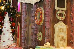 The gingerbread castle's hand-painted brickwork, delicate spun sugar windows and other delightfully sweet details