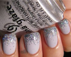Gray nails with glitter tips.