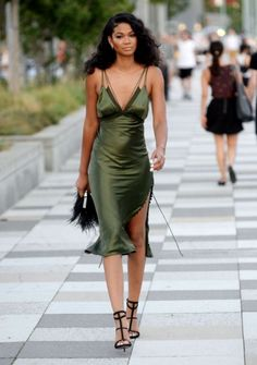 Model Chanel Iman rocking a green Alexander Wang slip satin dress with caged black heels. A bit out of the ordinary, perhaps, but we think it's stunning! | Mesonista