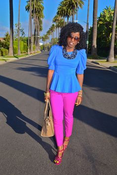 Bright colored pink purple neon cropped pants, cute as can be blue peplum, puffy shoulders. this girl is adorable and stylish!!