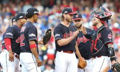 Cleveland Indians Josh Tomlin gets congrats from catcher Roberto Perez and the infield, Tomlin pulled in the 6th inning, against the Toronto Blue Jays,  game 2 of the ALCS at Progressive Field, in Cleveland, Ohio on Oct. 15, 2016.   Tomlin got the 2-1 win over the Jays.  (Chuck Crow/The Plain Dealer)