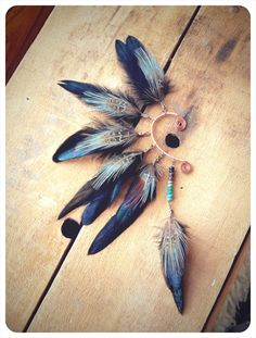 awake a tribal feathered ear cuff 'made to by RunWithTheTribe, $39.00