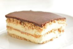 This chocolate eclair cake is such an easy dessert! And it tastes AMAZING with its creamy and delicious layers!! Just like a chocolate eclair, but in a cake. Mmmmm...
