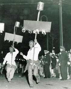 Mardi Gras flambeaux carriers, New Orleans.
