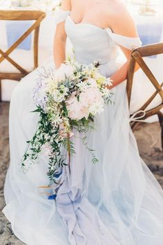 Blue wedding gown with cascading bouquet