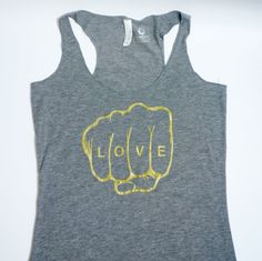 Hey, I found this really awesome Etsy listing at https://www.etsy.com/listing/186625466/gold-graphic-tank-top-womens-tee