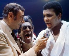 Howard Cosell interviews Ali, with entertainer Sammy Davis Jr. in the middle, after his victory over... - Neil Leifer for Sports Illustrated