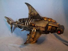 This is a 1 of 6 limited edition Marine Life series Steam Punk Plastiko-Bot Hammer Head Shark created By Claudio Garzón of Save Oceans & Seas