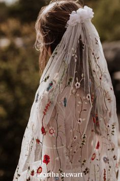 Bohemian brides, this colorful, embroidered veil by Elodie Courtat is for you. Filled with climbing cherry blossom vines and daisies, the veil has one additional floral touch: A textured petal topper, placed where the veil is pushed into the hair. #weddingideas #wedding #marthstewartwedding #weddingplanning #weddingchecklist Dream Wedding Dresses, Wedding Gowns, Lace Wedding, Bridal Veils, Wedding Cakes, Wedding Rings, Nontraditional Wedding Dresses, Floral Wedding Dresses, Woodland Wedding Dress