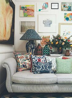 Striped couch with patterned accent pillows.
