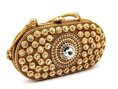 Miraculous gold plated brass metal #Clutch ornamented with glittering crystals. Item Code : SJBP2002 http://www.bharatplaza.com/new-arrivals/accessories.html.