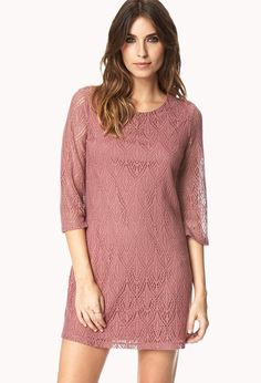 e06ec8cc8d5 A shift dress featuring a crochet pattern and 3 4 sleeves. Round neckline.