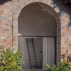 Noémie Meney creates modern summerhouse  inside French garden pavilion