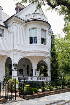 Two Meeting Street Inn | Charleston #exterior #house #curb #appeal #facade #ornate #victorian #arches #iron #fence #gate #wrough #white #balcony #turret