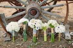 burlap and twine wrapped bouquets varying sizes and flowers but all same color