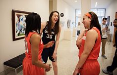 UConn's Breanna Stewart shares a laugh with Syracuse's Brianna Butler, right, and Brittney Sykes, left, in between Final Four media sessions.
