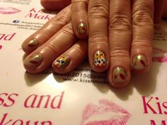 Great manicure and autumnal nail art. I did this free hand using Bluesky polish as a base colour and Born Pretty, Konad and MoYou for the owls and leaves. I used gold, green, orange, yellow, black and white for the art and light brown for the base.