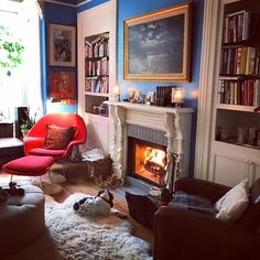 Daytime fire for a rainy morning. Rainy Morning, Morning Call, Maximalist Interior, House Tours, Fire, Interiors, Mornings, Bookcase, Home Decor