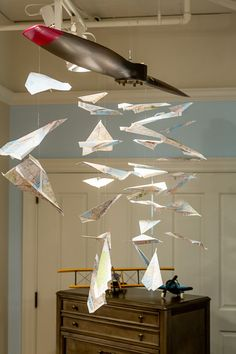 paper plane mobile // use a stick from the yard to hang them from