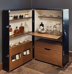 The ultimate gift for the supreme drinks connoisseur is an attractive leather drinks cabinet (£7,704) – the perfect space to store all his liquors.