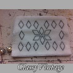 Vintage beaded clutch Off white beaded bad with diamond pattern design in dark brim beads. Kiss lock and satin interior. One mirror slot pocket. Metal hinged frame. Gently used . There are handle hinges on inside to add a strap . 7 inches  long and  5 high. Vintage Bags Clutches & Wristlets
