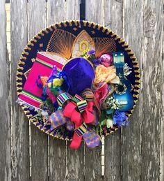 A personal favorite from my Etsy shop https://www.etsy.com/listing/270667045/fiesta-sombrero-wreath-fiesta-wreath