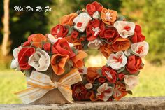 ghirlanda fiorita e vaso