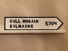 This sign is a replica of any Irish road sign. It is made of solid wood that has been sanded and hand painted. The letters are also wood are glued
