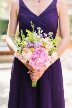 Purple Bridesmaids Dresses from J.Crew. Colorful Bouquets from Occasion9.com. See more here: http://www.StyleMePretty.com/2014/05/16/colorful-modern-meets-rustic-wedding/ Photography: ShannenNorman.com