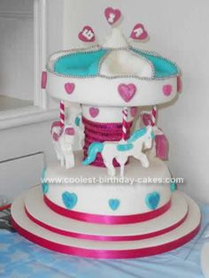 Homemade Carousel 1st Birthday Cake: My sister in law and I decided that we would bake a cake for her daughter's 1st birthday party. We were not 100% sure on what type of cake to make until