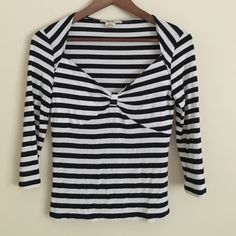 "Michael Kors black white striped V-neck cotton top Trendy and stylish Michael Kors black and white striped nautical top features three-quarter length sleeve, cute V-neck with cinched band to accentuate design across chest. Cotton spandex material in size small. Dimension 32"" chest, 28"" waist,  20"" length, 16"" shoulder, and 17"" long sleeves Michael Kors Tops Tees - Long Sleeve"