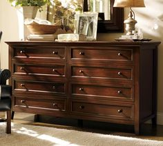 Paneled and dovetailed drawers ornamental molding metal pulls and generous lines recall the artistry of Craftsman-style design in our Hudson Extra-Wide Dresser The dresser has eight drawers including two with velvet-lined compartments to protect