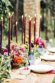 If you want to use maroon as more of an accent for your tablescapes, these long candles are definitely the way to go. Surrounded by luscious flowers and clear glassware, the dark tapers give the whole table an extra pop of color. @myweddingdotcom