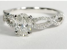 Dream Engagement Ring: infinity twist micropave 4 prong head, simple round cut! <3