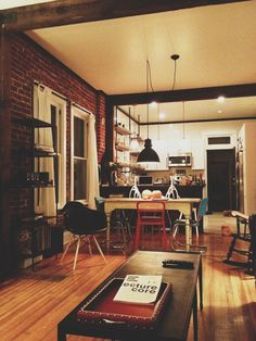 holy crap this is truly the most accurate depiction of what my mental dream house is. god the lighting and the exposed brick and those kitchen shelves. PERFECTION.