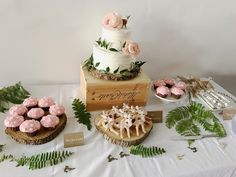 Deer/woodland boho desert table. Deer cookies, mushrooms cupcakes, chocolate twigs, and a beautiful deer cake with Japanese rananculus and ruscus greenery. I decorated with some fern from my friends backyard, use some wood pieces from a friends wedding to give it that woodsy feel, & made labels with white chalk pen on kraft paper.
