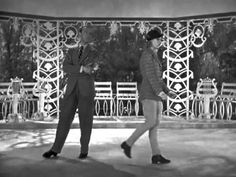 Top Hat: Isn't This a Lovely Day (To Be Caught in the Rain) Astaire/Rogers. Aww, I love this scene and these two.