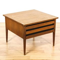 """This """"Dillingham"""" end table is featured in a solid wood with a distressed cherry finish. This mid century modern side table has 1 drawer, tapered legs and carved black painted details. Stylish table perfect as a nightstand! #midcenturymodern #tables #endtable #sandiegovintage #vintagefurniture"""