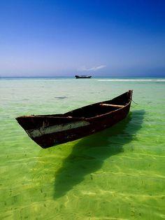Small boat in the sea, Dahlak islands, Eritrea by Eric Lafforgue, via Flickr