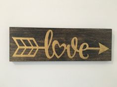 DIY Love Arrow Sign Inspiration! A wood sign with gold decor that can be used as part of gallery decor or as decor in a nursery. Nice Valentine's day decorations are always hard come by. Don't feel like DIYing this project? You can buy it etsy.