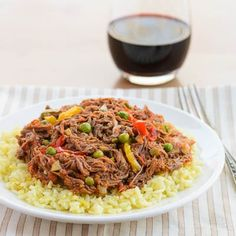 A recipe for ropa vieja, a braised and shredded beef dish made with bell peppers, tomatoes, olives, and cumin.